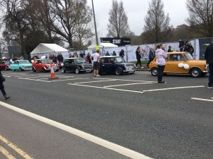 The Marathon caravan of Minis heads past Preston Park heralding the arrival of the elite runners.  Picture by Tim Hodges.